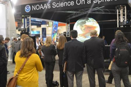 NOAA personnel interacting with attendees at 2015 American Meteorological Society Annual Meeting NOAA